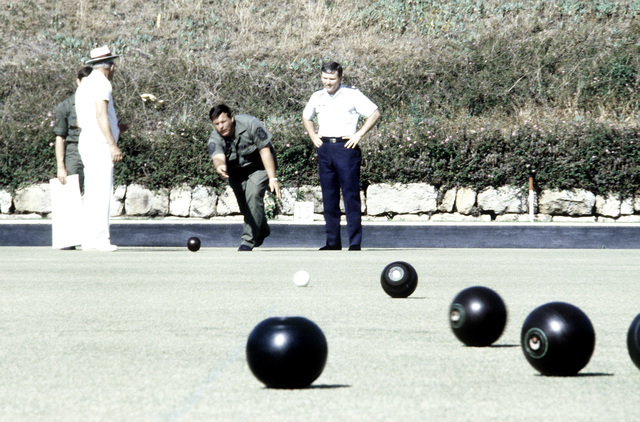 SMSGT McKean tries his hand at lawn bowling while CPT Mike Schlatter, 1363 Audio Visual Squadron, Det. 6, watches. The men are participating in exercise Kangaroo '81