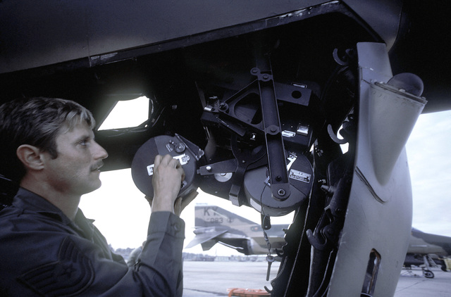 The flight crew removes film from camera equipment installed on an F-4E Phantom II aircraft upon returning from a mission during exercise PHOTO Finish '81