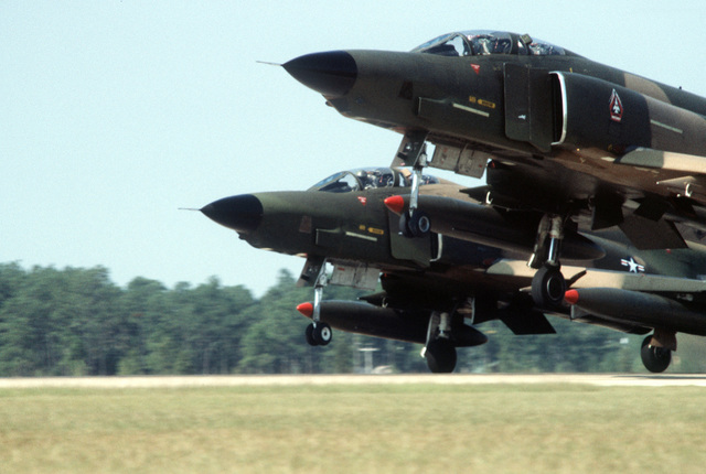 Two F-4E Phantom II aircraft on the flight line during exercise PHOTO Finish '81