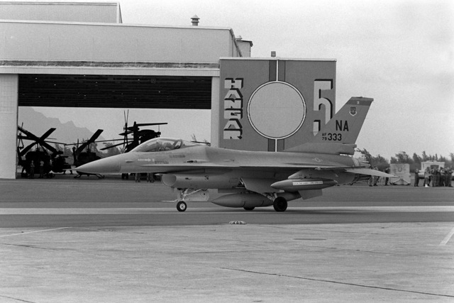 An Air Force F-16A Fighting Falcon aircraft taxis in front of hangar #5. The F-16A is from the 428th Tactical Fighter Squadron located at Nellis Air Force Base, Nev., and is at the Marine Corps Air Station to fly with Marine F-4 Phantom aircraft in support of Hawaii-based Army units during a joint chiefs of staff exercise which will last from Oct. 2nd to Nov. 2nd