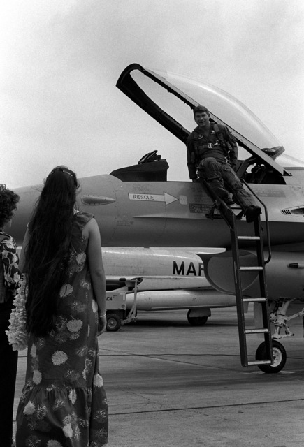 By the time this Air Force F-16A Fighting Falcon aircraft came to a stop, there were at least two ladies there to welcome the pilot, Hawaiian style. The F-16A is from the 428th Tactical Fighter Squadron located at Nellis Air Force Base, Nevada, and is here to fly with Marine F-4 Phantom aircraft in support of Hawaii-based Army units. The event is a Joint Chiefs of STAFF exercise, which will last for one month (2 Oct - 2 Nov)