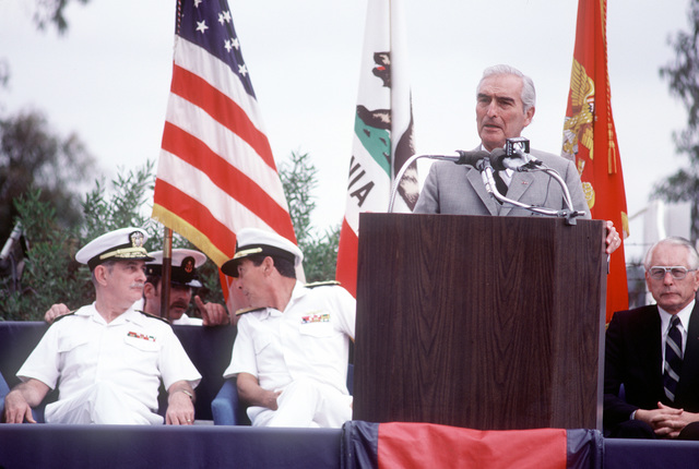 Former Secretary of the Navy Edward Hidalgo speaks during the ground breaking ceremony for the new Naval Regional Medical Center. Seated behind him are (L-R): Vice Adm. J. William Cox, chief, Bureau of Medicine and Surgery and surgeon general of the Navy; Rear Adm. Eustine P. Rucci, commanding officer, Naval Regional Medical Center; Rear Adm. P. Gillcrist, commander, Naval Base, San Diego; Cmdr. M. Hopper, officer in charge of construction, Western Division Naval Facilities Engineering Command, and Capt. C.C. Atkins, director of clinical services, Naval Regional Medical Center