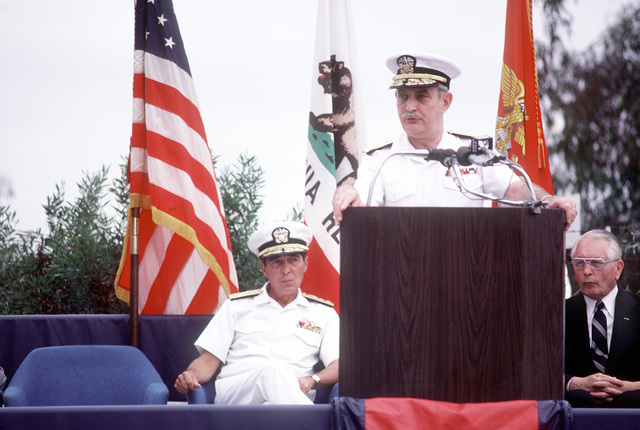 Vice Adm. J.W. Cox, chief, Bureau of Medicine and Surgery and surgeon general of the Navy, speaks during the ground breaking ceremony for the new Naval Regional Medical Center. Seated behind him are (L-R): Rear Adm. Eustine P. Rucci, commanding officer, Naval Regional Medical Center; Rear Adm. P. Gillcrist, commander, Naval Base, San Diego; Cmdr. M. Hopper, officer in charge of construction, Western Division Naval Facilities Engineering Command, and Capt. C.C. Atkins, director of clinical services, Naval Regional Medical Center.