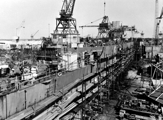 A starboard quarter view of the destroyer HAYLER (DD-997) with scaffolding during construction by Ingalls Shipbuilding. The ship is 40 percent complete