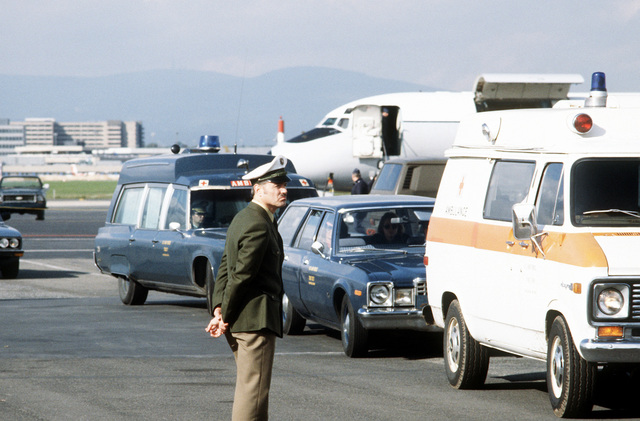 A convoy of ambulances departs the ramp area for a trip to Wiesbaden Hospital, after the transfer of patients from a 55th Aeromedical Airlift Squadron C-9A Nightingale aircraft. The vehicles contain four Americans and the Belgian Ambassador to Egypt, wounded during the assassination of Egyptian President Anwar Sadat