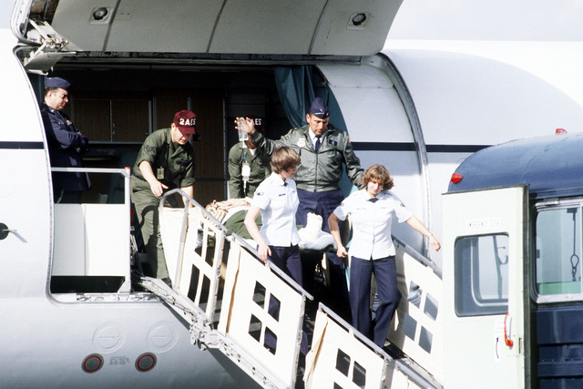 CPT Christopher Ryan, assigned to European Command Headquarters, is transferred from a 55th Aeromedical Airlift Squadron C-9A Nightingale aircraft, to a medical bus that will take them to Wiesbaden Hospital. Ryan was one of four Americans wounded during the assassination of Egyptian President Anwar Sadat