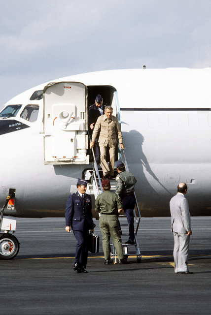Fred Golden disembarks a C-9A Nightingale aircraft from the 55th Aeromedical Airlift Squadron, and will board a medical bus that will take him to Wiesbaden Hospital. Golden was one of four Americans wounded during the assassination of Egyptian President Anwar Sadat