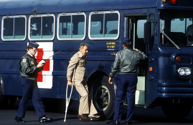Fred Golden walks, with the aid of crutches, to a medical bus that will take them to Wiesbaden Hospital, after disembarking a C-9A Nightingale aircraft from the 55th Aeromedical Airlift Squadron. Golden was one of four Americans wounded during the assassination of Egyptian President Anwar Sadat