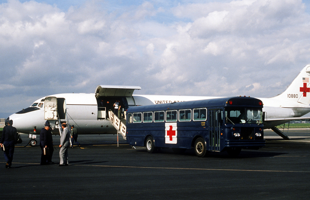 Left side view of a C-9A Nightingale aircraft from the 55th Aeromedical Airlift Squadron, during the transfer of four Americans and the Belgian ambassador to Egypt, to a medical bus that will take them to Wiesbaden Hospital. The five men were wounded during the assassination of Egyptian President Anwar Sadat