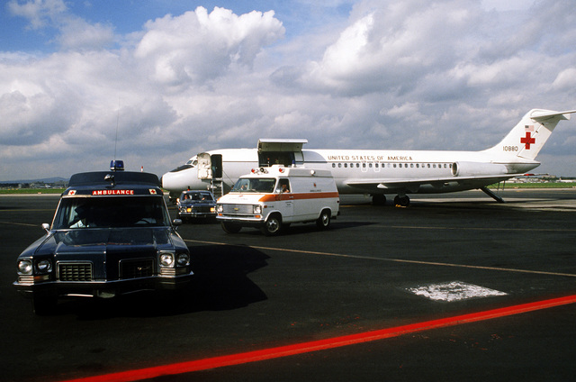 Left side view of a C-9A Nightingale aircraft from the 55th Aeromedical Airlift Squadron, during the transfer of four Americans and the Belgian ambassador to Egypt, to ambulances that will take them to Wiesbaden Hospital. The five men were wounded during the assassination of Egyptian President Anwar Sadat
