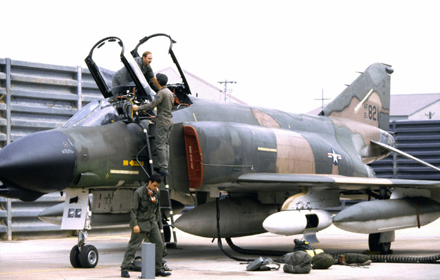 Maintenance crewmen from the 8th Tactical Fighter Wing make a pre-flight check, before the shakedown flight of an F-4 Phantom II aircraft that was recently transferred from another unit