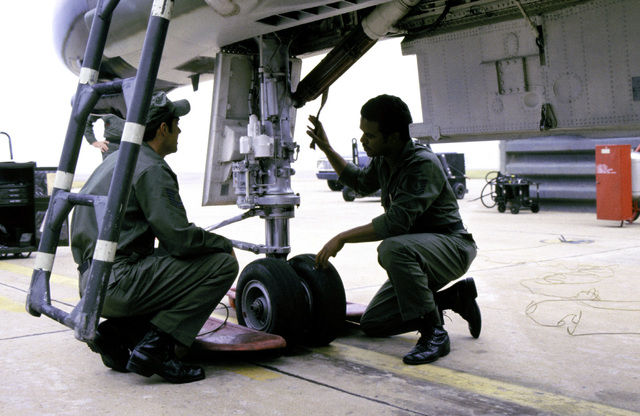 Maintenance crewmen from the Eighth Tactical Fighter Wing make a pre-flight check, before the shakedown flight of an F-4 Phantom II aircraft that was recently transferred from another unit
