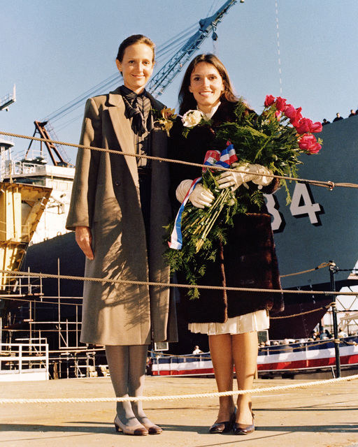 Mrs. Fracesca Ferguson, sponsor, right, stands in front of is the Oliver Hazard Perry class guided missile frigate USS AUBREY FITCH (FFG 34) prior to the beginning of its launch ceremony