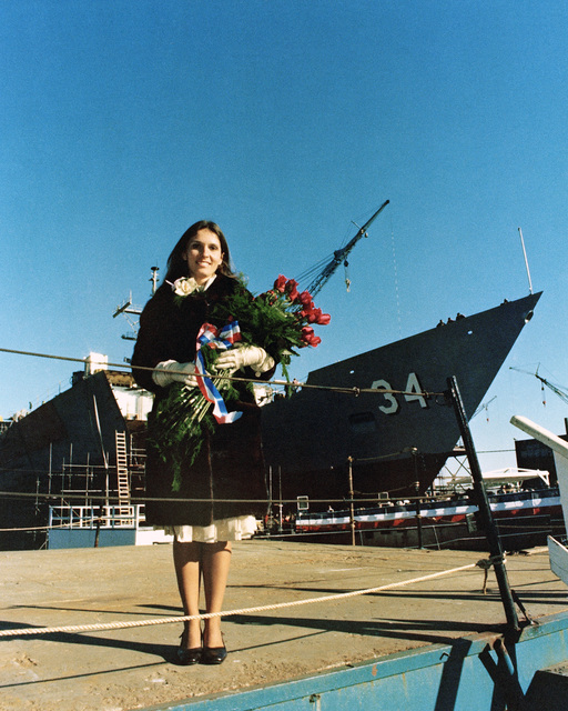 Mrs. Fracesca Ferguson, sponsor, stands in front of is the Oliver Hazard Perry class guided missile frigate USS AUBREY FITCH (FFG 34) prior to its launch ceremony