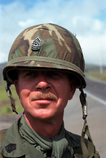 Command SGM John L. Hollis of the 1ST Bn., 35th Inf. Div., looks on as the final advance towards the opposing forces gets underway during Operation Thunderbolt