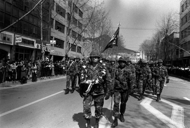 Members of the 25th Infantry Division from Schofield Barracks, Hawaii, march in a parade during their deployment to participate in the joint Republic of Korea/U.S. training exercise Team Spirit '82