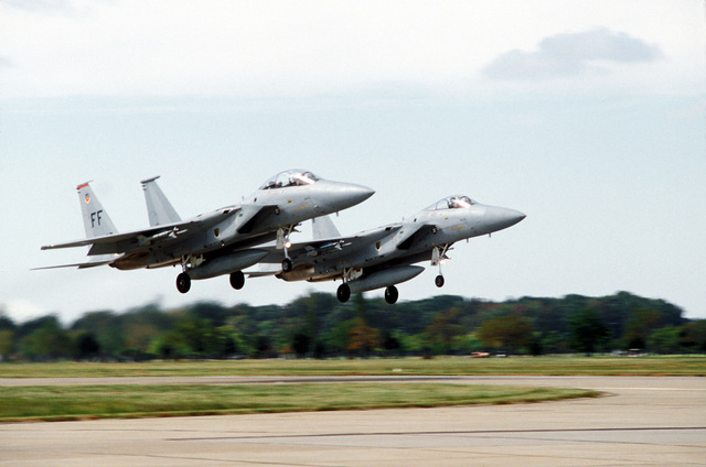 A view of two F-15 Eagle aircraft from the First Tactical Fighter Wing taking off to participate in the Yorktown Bicentennial Celebration