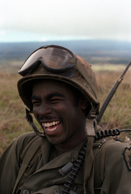 """PFC Gilton R. Moore of the 1ST Bn., 35th Inf., 25th Div., smiles as he is asked about his feelings on the field training exercise Operation Thunderbolt. His answer was """"this is great infantry country and I enjoy the training."""""""
