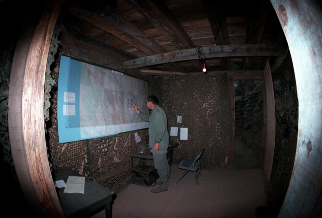 The interior of the underground Tactical Operations Center being used by the S-3 Section of the 2nd Brigade, 25th Infantry Division, during Operation Thunderbolt