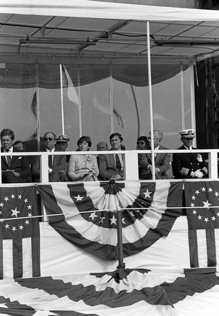 Secretary of the Navy John F. Lehman Jr., center, and Joan Clark, wife of national security advisor William P. Clark, observe activities taking place during the launching ceremony for the nuclear-powered strategic missile submarine HENRY M. JACKSON (SSBN-730)