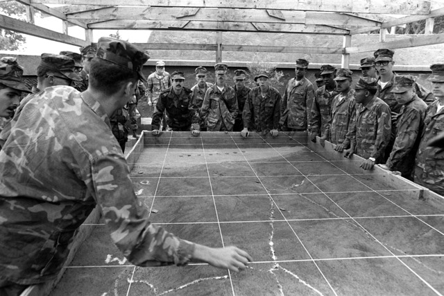 U.S. Marines are from Co. K, 3rd Bn., 6th Mar., are given a briefing on the area of operation for the amphibious landing exercise, Unitas XXII, that will take place here in Chile
