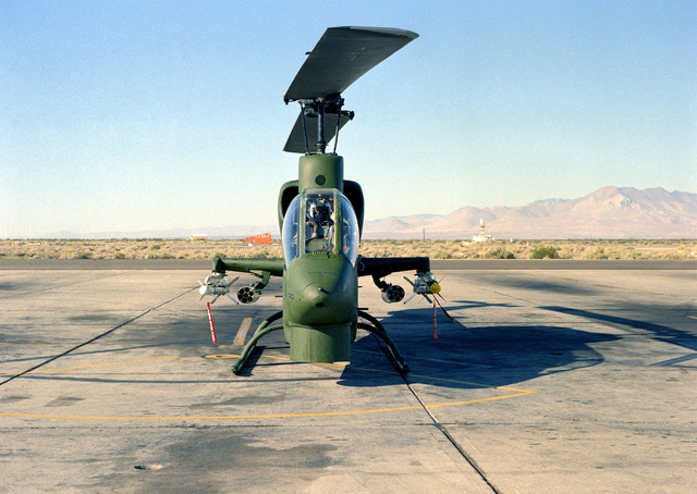 Front view of an AH-1 Sea Cobra helicopter armed with two Sidearm missiles