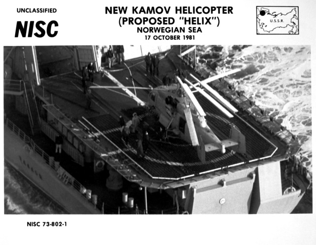 A left side view of a Soviet Helix helicopter on the helicopter pad of the Soviet guided missile destroyer USSR UDALOY (DDG-480) underway. The Kamov-built helicopter has anti-submarine capabilities
