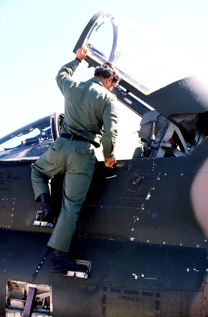A technical sergeant from the 198th Tactical Fighter Squadron, 156th Tactical Fighter Wing, conducts a preflight inspection of his A-7 Corsair II aircraft during exercise BOLD EAGLE '82