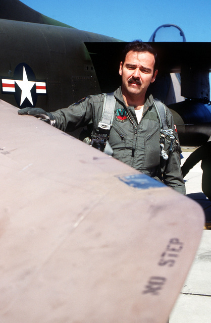 Captain Eduardo Emnanuelli, 198th Tactical Fighter Squadron, 156th Tactical Fighter Wing, conducts a preflight inspection of his A-7 Corsair II aircraft during exercise BOLD EAGLE '82