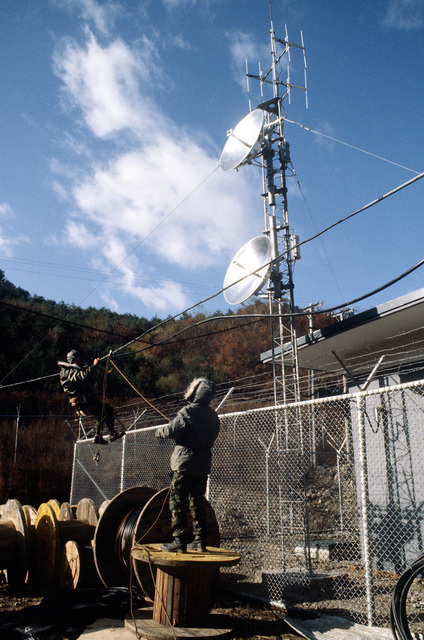 1827th Engineering Installations Squadron members set-up the Televised Optical Surveillance System antenna at the Korean Operational Tactical Air Range (KOTAR). The KOTAR, assigned to the 51st Services Squadron, is under construction during Exercise Commando Crest
