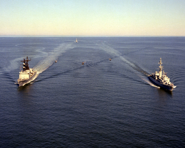 A port bow view of the destroyer USS COMTE DE GRASSE (DD-974) and a starboard bow view of the French destroyer DE GRASSE (D-612) underway near Cape Henry on their way to Norfolk Naval Base. The ships participated in the joint U.S./French bicentennial celebration at Yorktown, Va