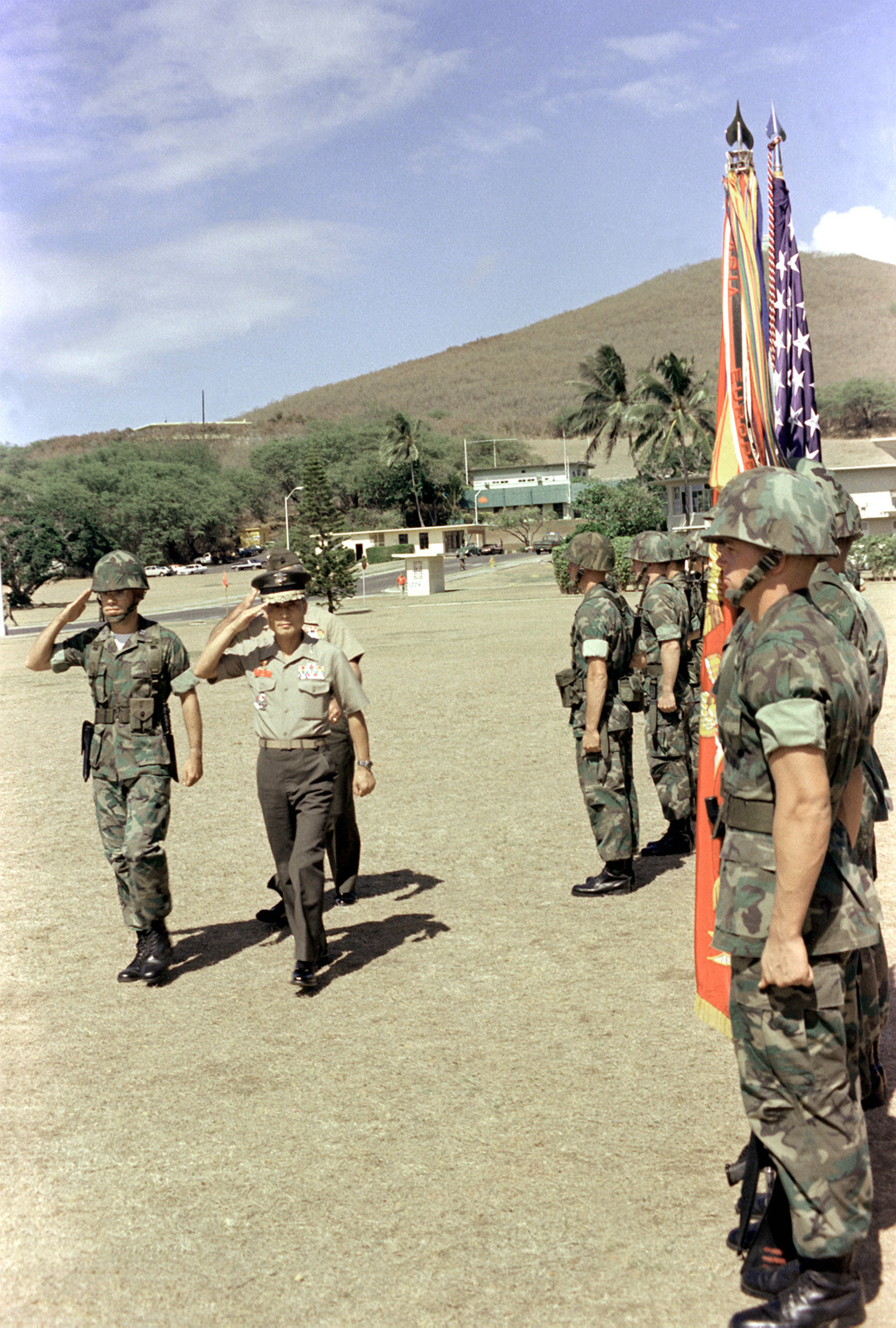 LGEN Choi Ki Duk, second vice chief of naval operations, Korea, salutes the flag as he passes the 1ST Marine Brigade Honor Guard welcoming him for a visit