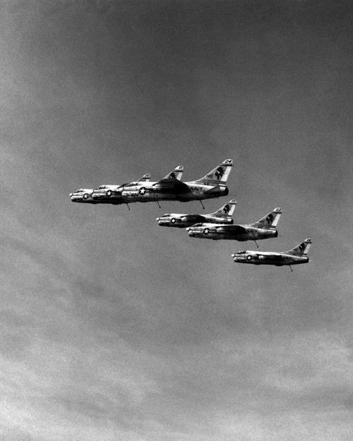 An air-to-air left side view of six A-7E Corsair II aircraft from Attack Squadron 87 (VA-87). The aircraft are assigned to Carrier Air Wing 6 (CVW-6), based aboard the aircraft carrier USS INDEPENDENCE (CV 62)