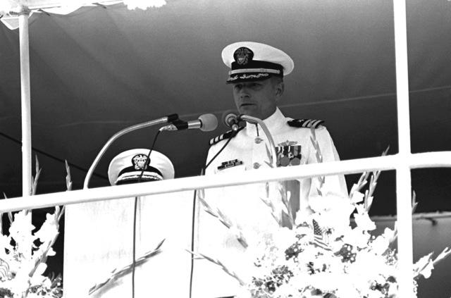 CDR Harold V. Maixner Jr., commanding officer, speaks during the commissioning ceremony of the guided missile destroyer USS SCOTT (DDG-995)