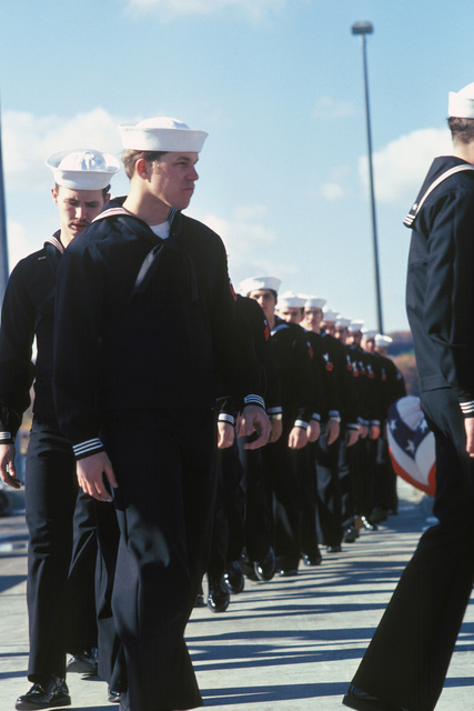 Crew members go aboard ship during the commissioning of the nuclear-powered attack submarine USS LA JOLLA (SSN 701)