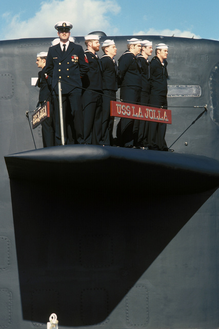 Crew members stand on the diving plane of the nuclear-powered attack submarine USS LA JOLLA (SSN 701) during the ship's commissioning