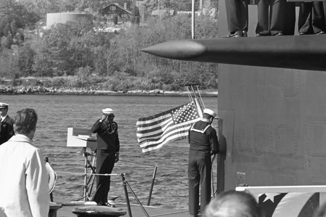 Crewmen raise the ensign during the commissioning of the nuclear-powered attack submarine USS LA JOLLA (SSN 701)