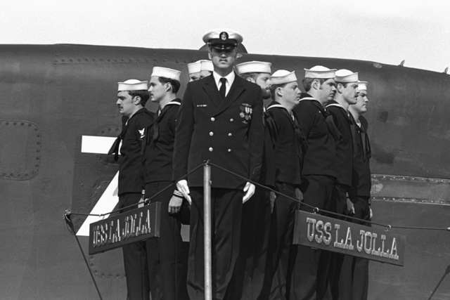 Crewmen stand at attention on the diving plane of the nuclear-powered attack submarine USS LA JOLLA (SSN 701) during the ship's commissioning