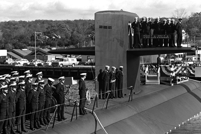 Crewmen stand at attention to welcome platform guests aboard for the commissioning of the nuclear-powered attack submarine USS LA JOLLA (SSN 701)