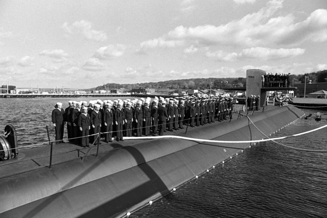 Crewmen stand in formation on deck during the commissioning of the nuclear-powered attack submarine USS LA JOLLA (SSN 701)