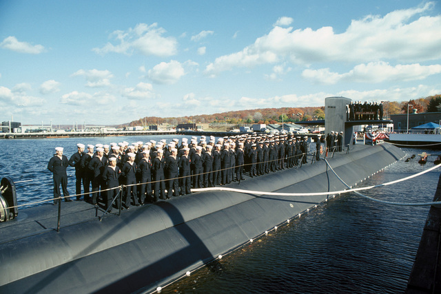 Crewmen stand on deck during the commissioning of the nuclear-powered attack submarine USS LA JOLLA (SSN 701)