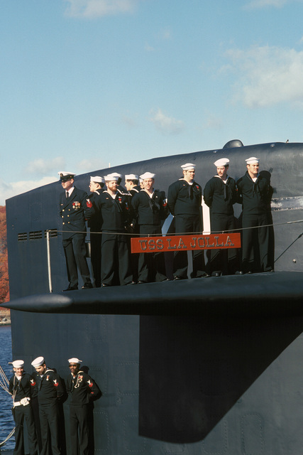 Crewmen stand on the diving plane of the nuclear-powered attack submarine USS LA JOLLA (SSN 701) during the ship's commissioning