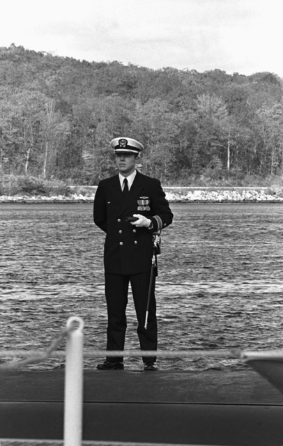 The officer of the deck mans his post during the commissioning of the nuclear-powered attack submarine USS LA JOLLA (SSN 701)