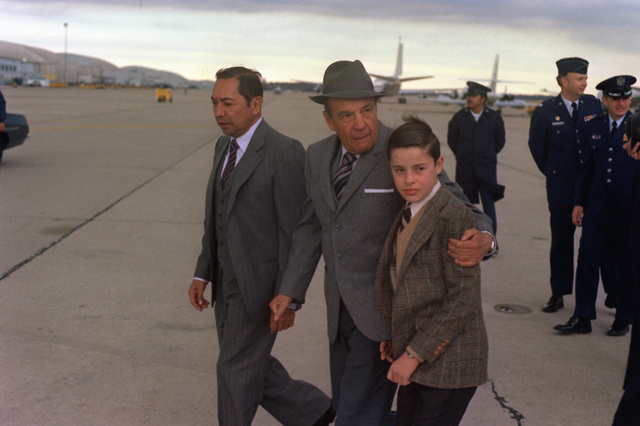 GEN Galvin of Mexico, center, walks toward the air terminal with his entourage upon arriving for a visit