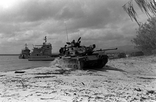 A Marine M-60A1 tank leaves the beach after being beached by a utility landing craft. The tank is a part of the 31st Marine Amphibious Unit which is taking part in Kangaroo 4 (1981)