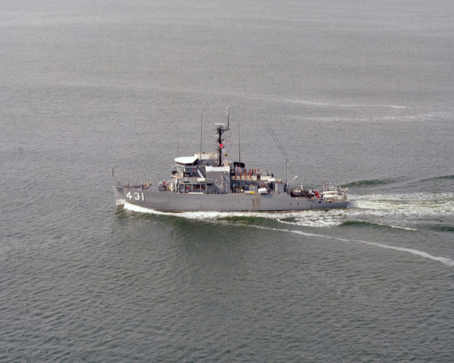 A port beam view of the ocean minesweeper USS DOMINANT (MSO 431) underway
