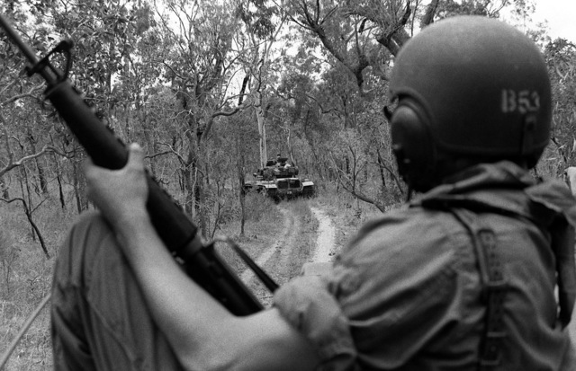 Marine M-60A1 tanks move through the woods in preparation to assault their objective during Kangaroo 4 (1981). The men and equipment are from the 31st Marine Amphibious Unit and headquartered aboard the amphibious assault ship USS OKINAWA (LPH-3)