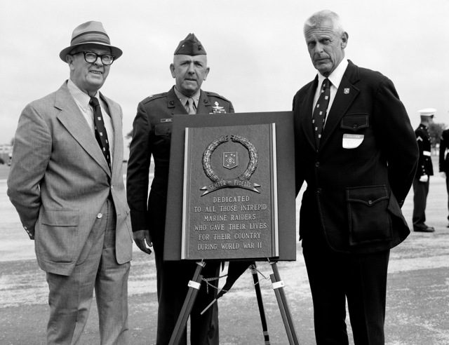 Retired MGEN Peatross, right, and retired COL J. Sexton, left, of the Marine Raider Association, presents a plaque to the Marine Corps Recruit Depot in honor of the Marine Raiders who gave their lives during World War II. BGEN William Weise, deputy commanding general receives the plaque