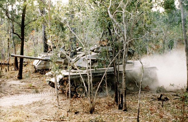 An M-60A1 tank attached to the 31st Marine Amphibious Unit (31st MAU) advances toward enemy forces during Exercise Kangaroo 4