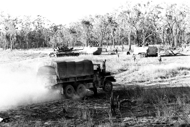 Marine M-60A1 tanks and landing vehicles, tracked, personnel (LVTP-7) refuel during Kangaroo 4 (1981) field exercise. The tanks and crews are from the 1ST Marine Division and are a part of the 31st Marine Amphibious Unit